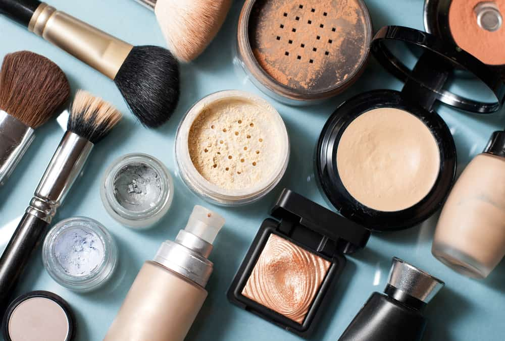 Various types of makeups against a blue background.