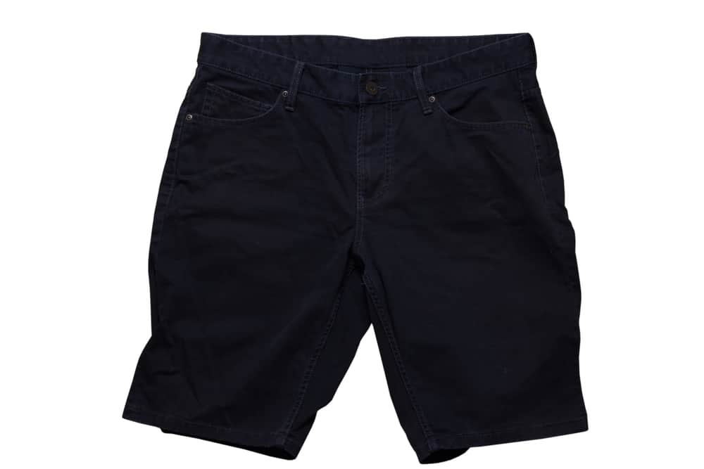 This is a close look at a pair of black denim shorts.