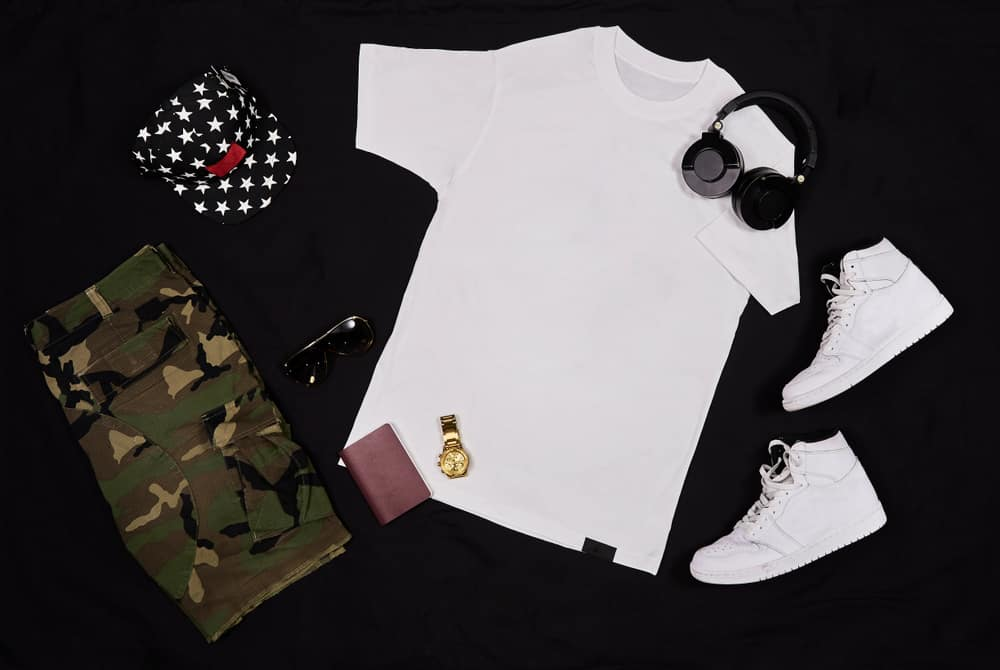 This is a close look at a complete outfit with accessories paired with a pair of camo shorts.