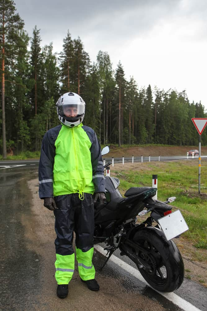 A rider wearing a full suit made of waterproof materials.