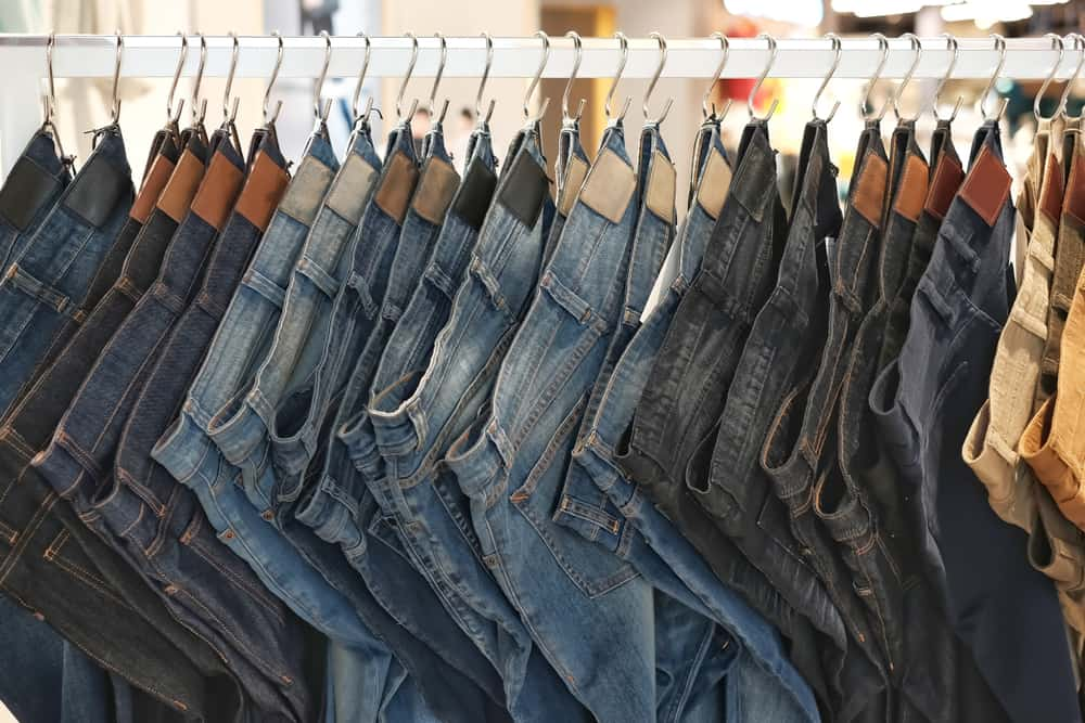 This is a close look at a row of various jeans on display.
