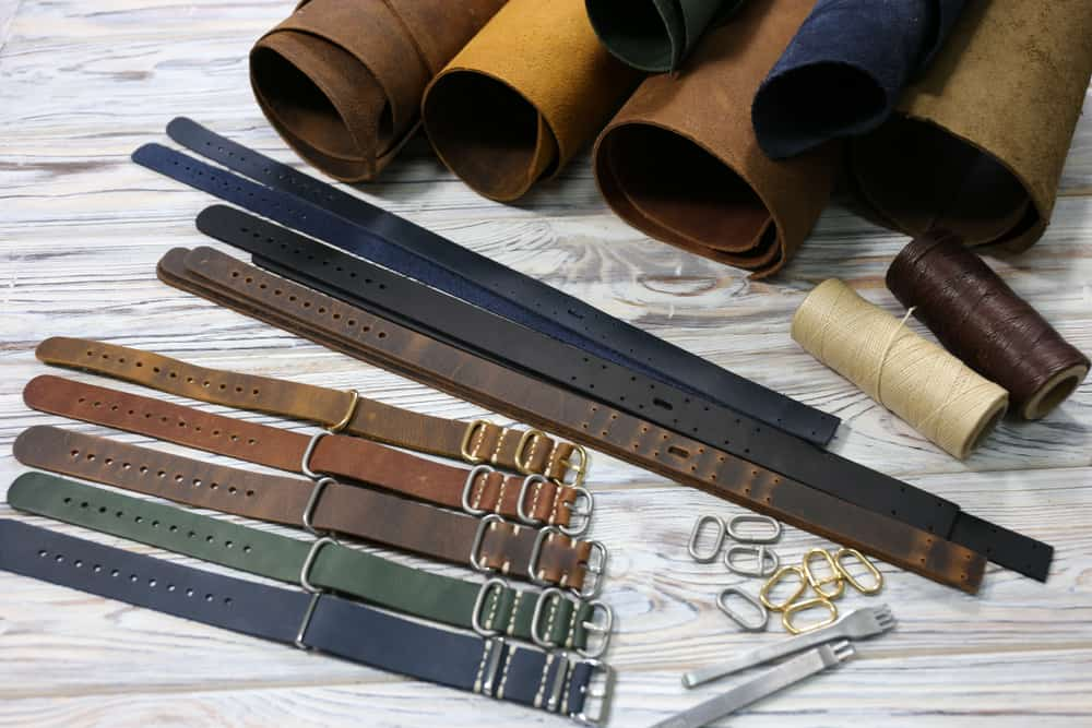 Various leather watch straps along with rolls of genuine leather.