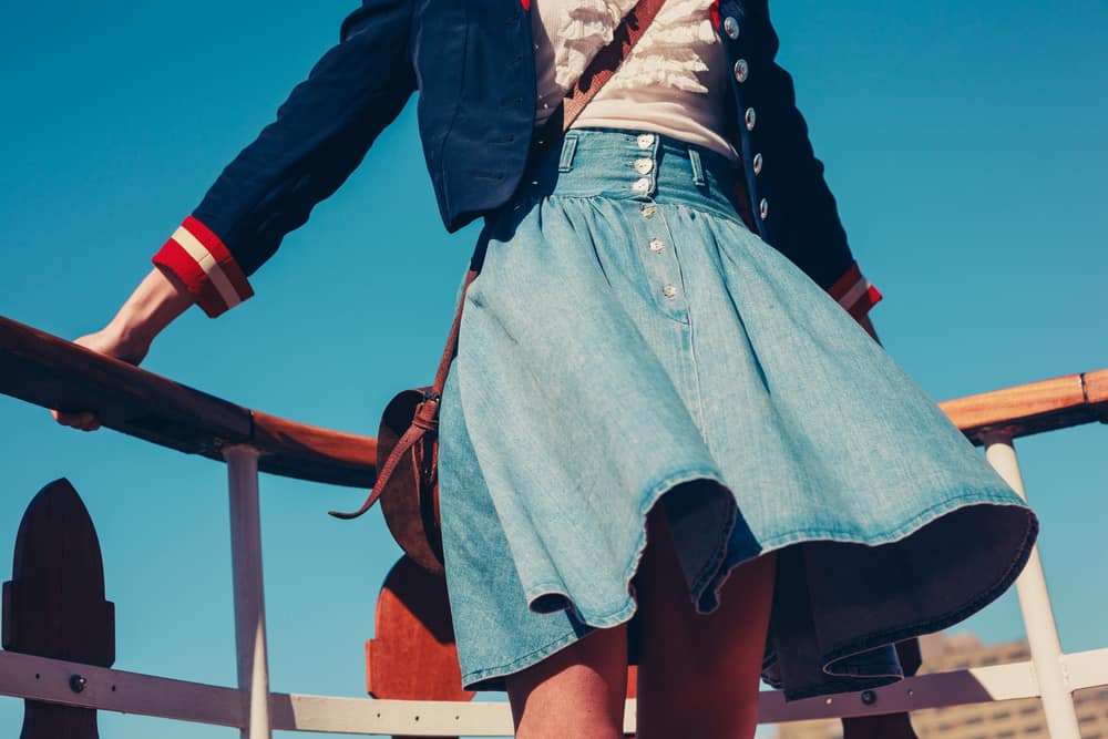 This is a woman wearing a denim skirt.