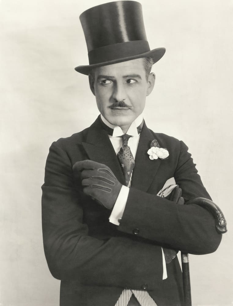 This is a vintage photo of a gentleman wearing a top hat.