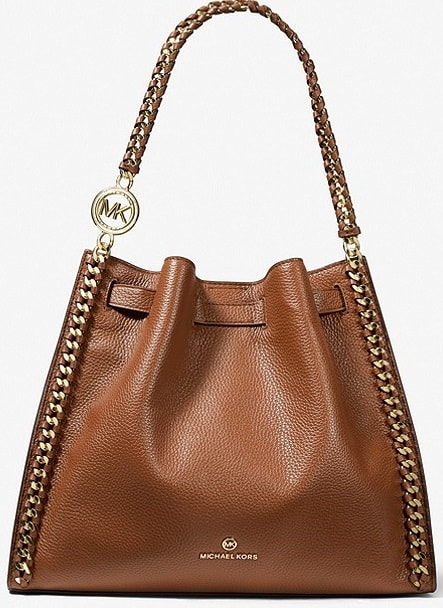 The Mina Large Pebbled Leather Shoulder Bag in brown leather by Michael Kors.