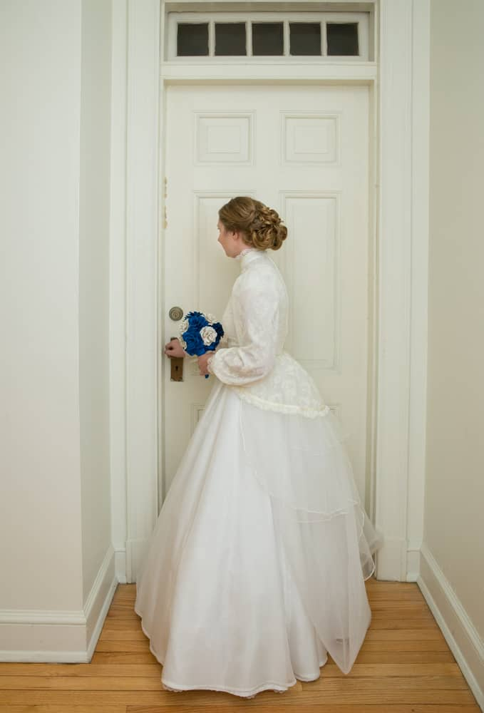 Young bride in a vintage wedding gown.