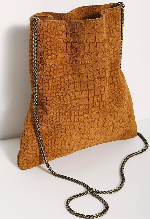The Nicolette Suede Crossbody in brown by Free People.