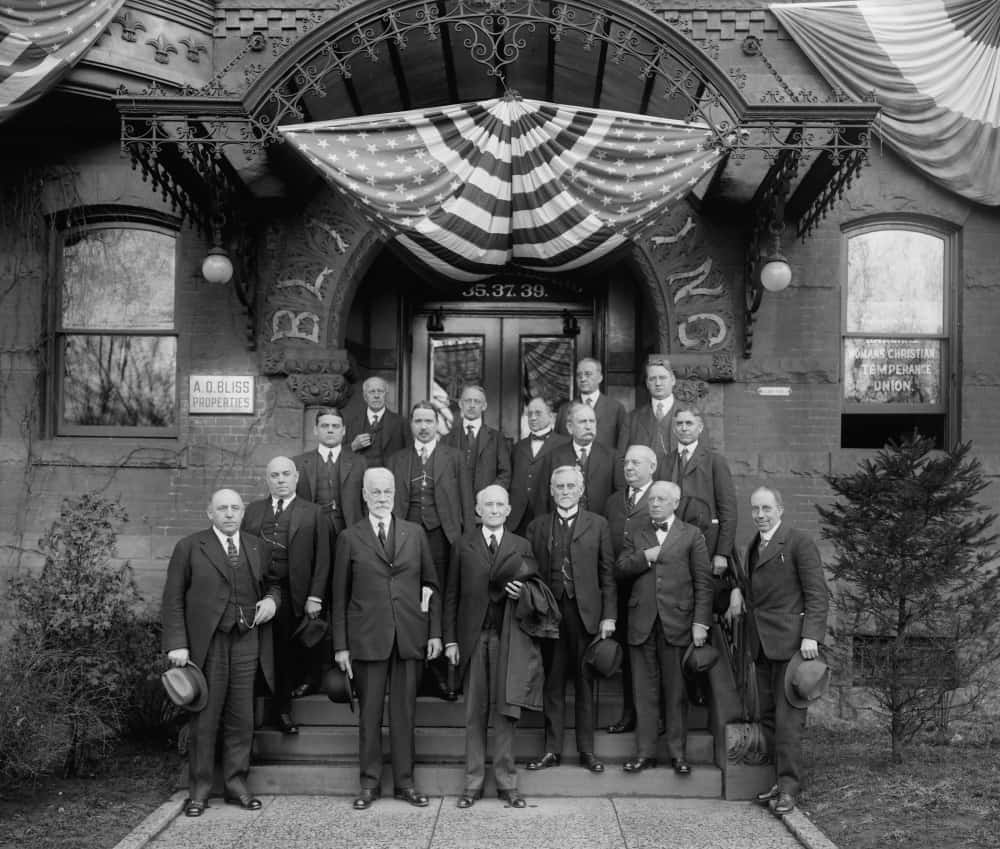 Wayne Bidwell Wheeler with a group of men standing on the steps of the Washington Headquarters of the National Woman's Christian Temperance.
