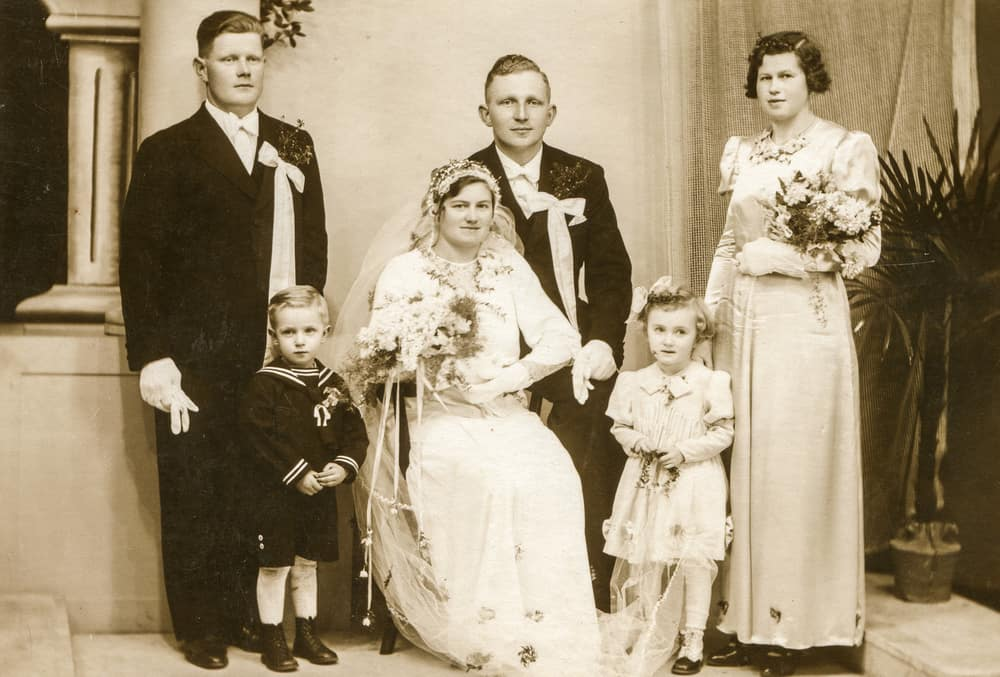 Vintage photo of newlyweds with the family.