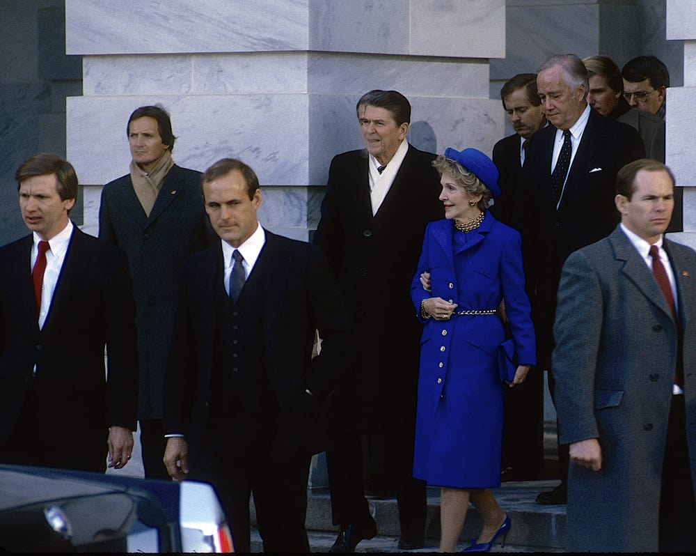 President Ronald Reagan and First Lady Nancy Reagan walk out of the US Capitol East Front Library door after Reagan renewed his Presidential oath of office.
