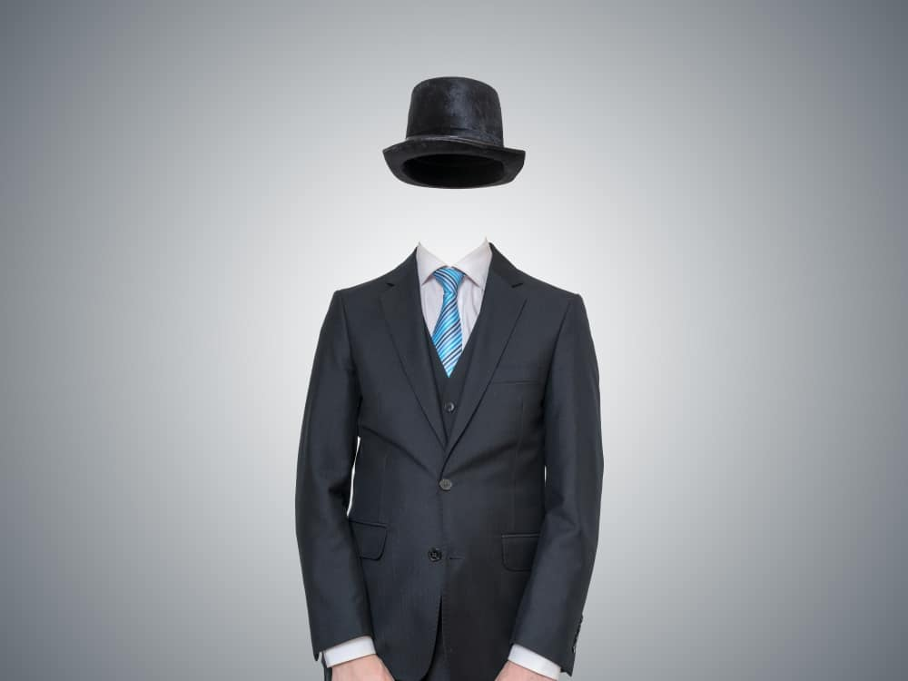 An invisible man wearing a full suit and a matching black bowler hat.