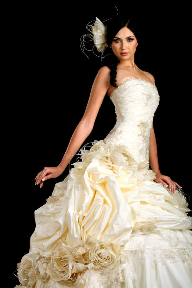 Bride wearing an intricate wedding gown with matching headdress.