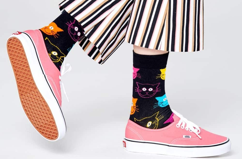 A pair of black cat socks with colorful patterns from Happy Socks.