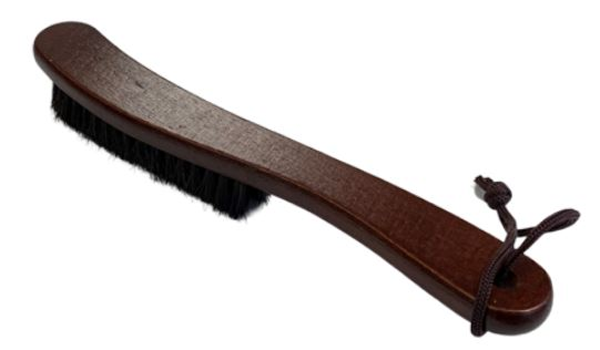 A fedora hat brush with wooden handle.
