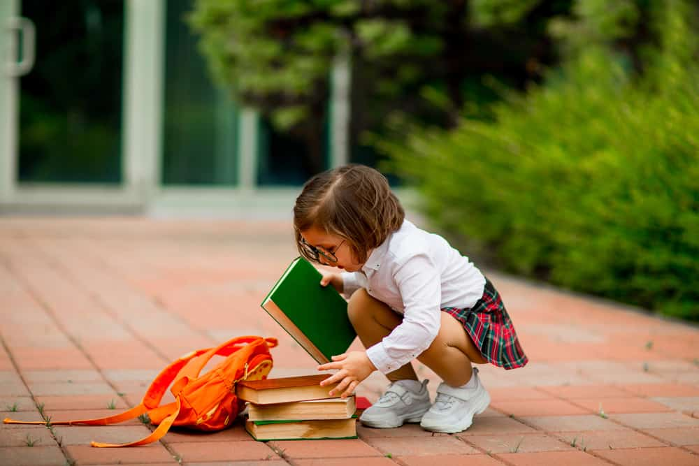 A girl wearing a school uniform.