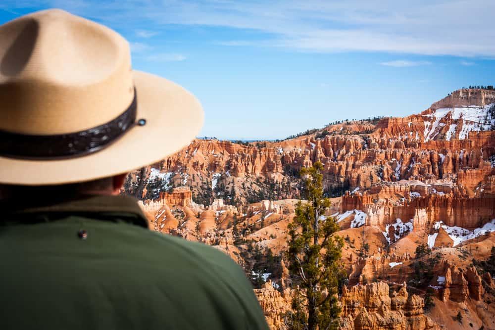 A US Park Ranger gazing at the canyon.