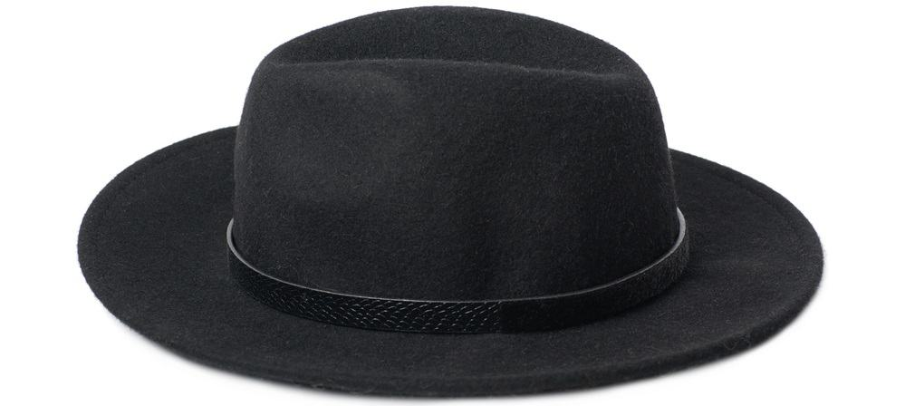 This is a close look at a pure black homburg hat.