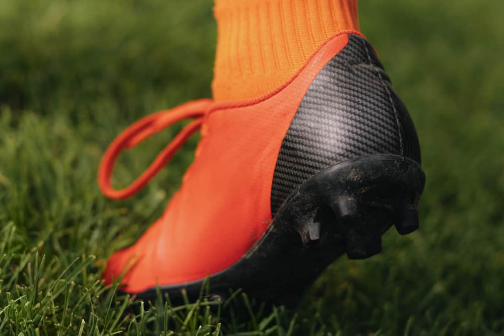 A close look at a football player wearing cleats.