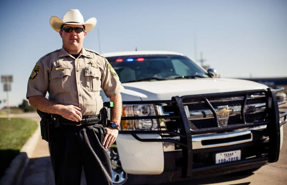 A Texas Police Officer with his truck.
