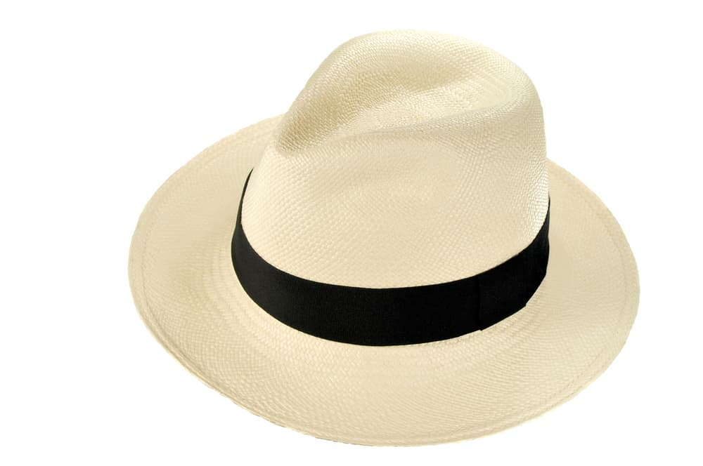 A traditional beige Panama hat with dark band.