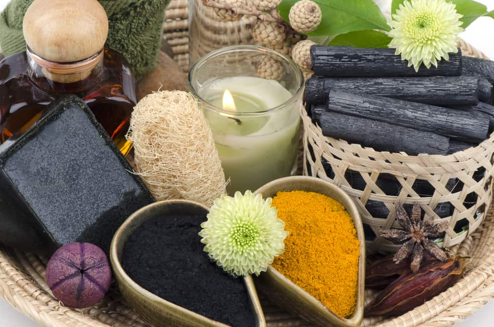 This is a close look at various charcoal bath products on a basket.
