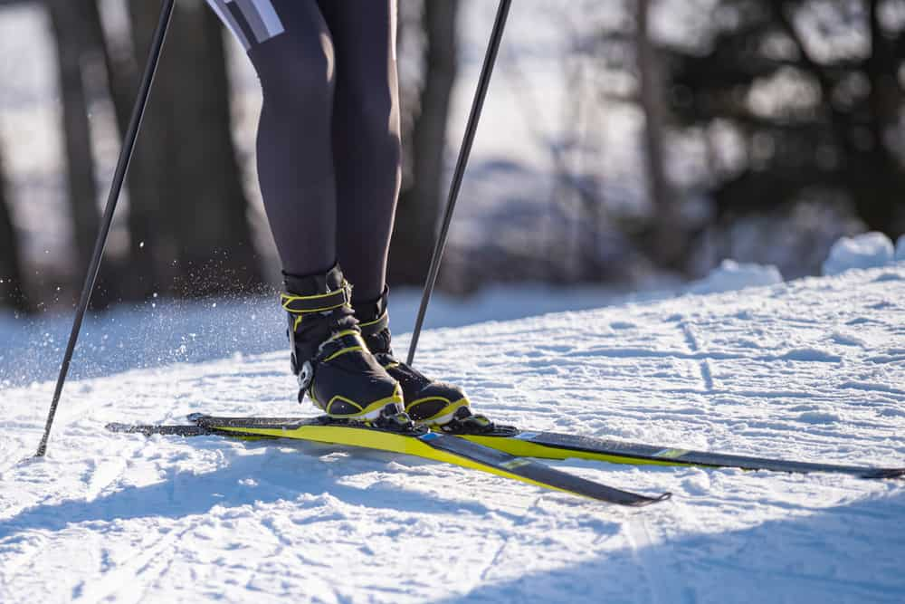 A close look at a skier wearing ski boots.