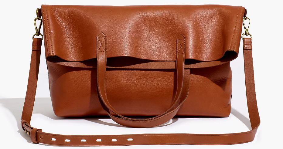 The Foldover Transport Tote in brown leather by Madewell.