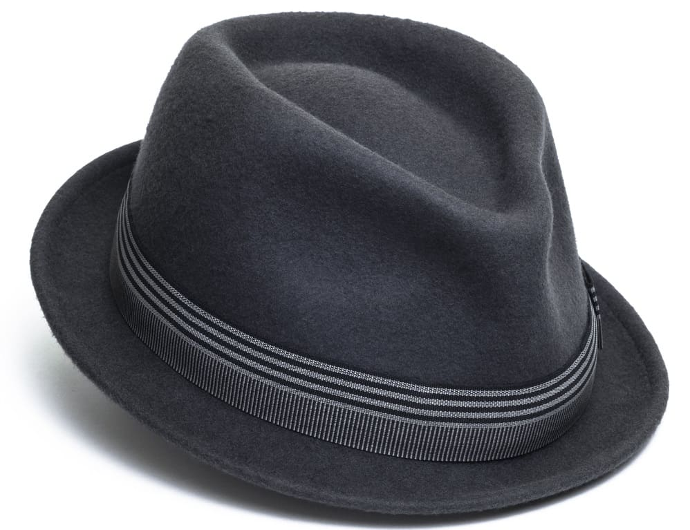 This is a close look at a dark gray trilby hat with patterned band.