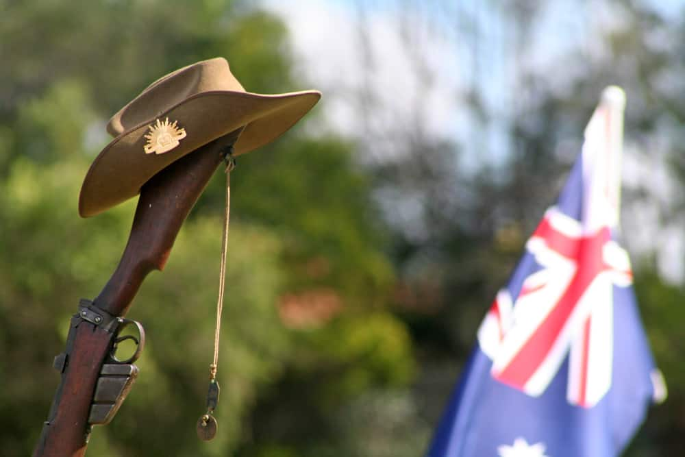 A close look at a slouch hat on a rifle.