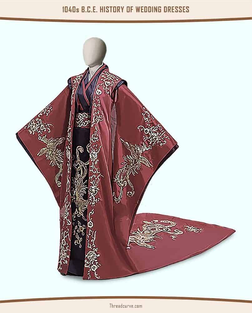 Mannequin wearing a black and red robe adorned with intricate embellishments.