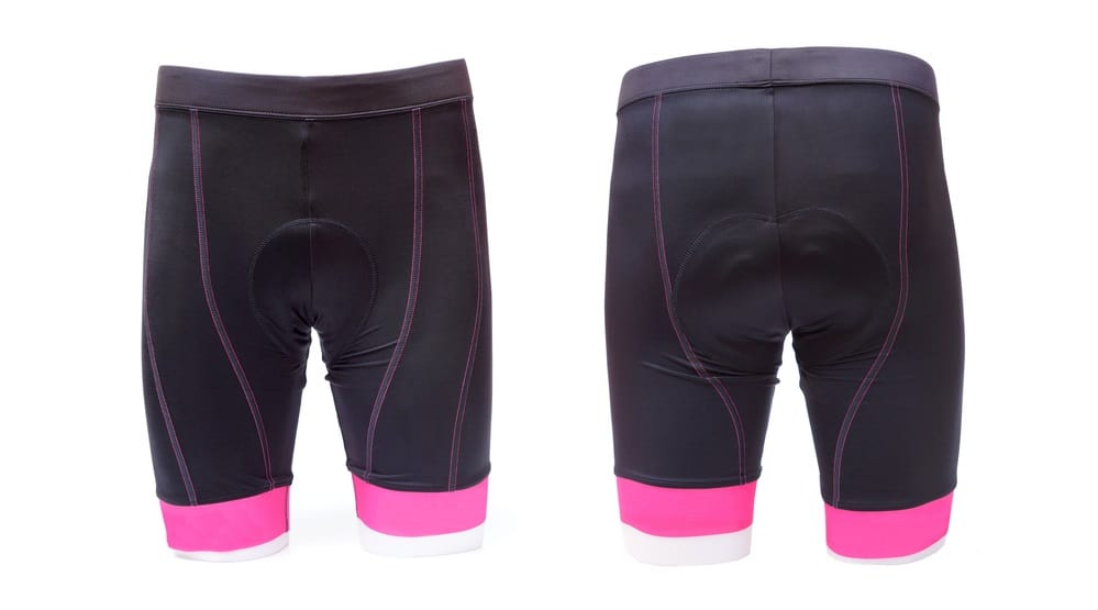 Front and back view of black padded shorts with pink trims.