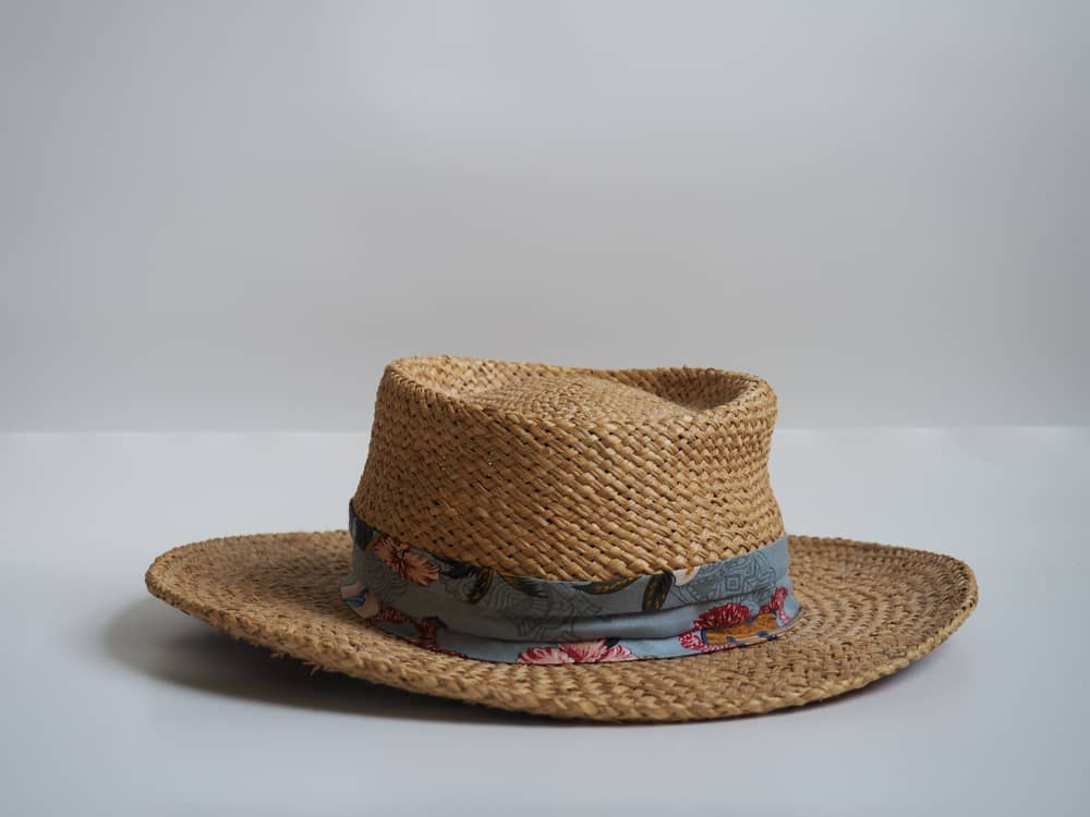 Toquilla straw hat with blue fabric strap.