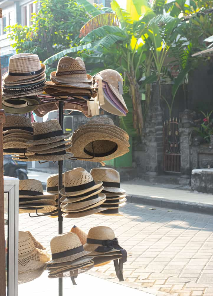 A display of toyo straw hats near the street.