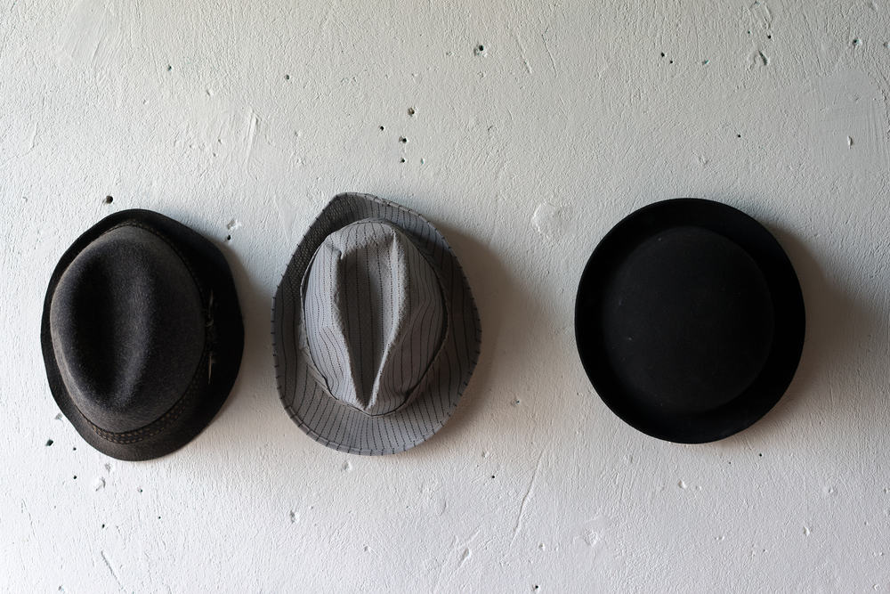A close look at a bowler hat, a fedora hat and a trilby hat.