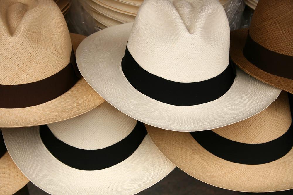 A close look at various panama hats on display.