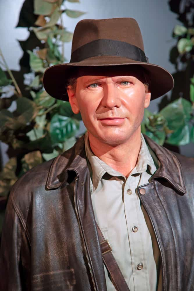 This is a close look at the wax statue of Indiana Jones wearing a fedora.