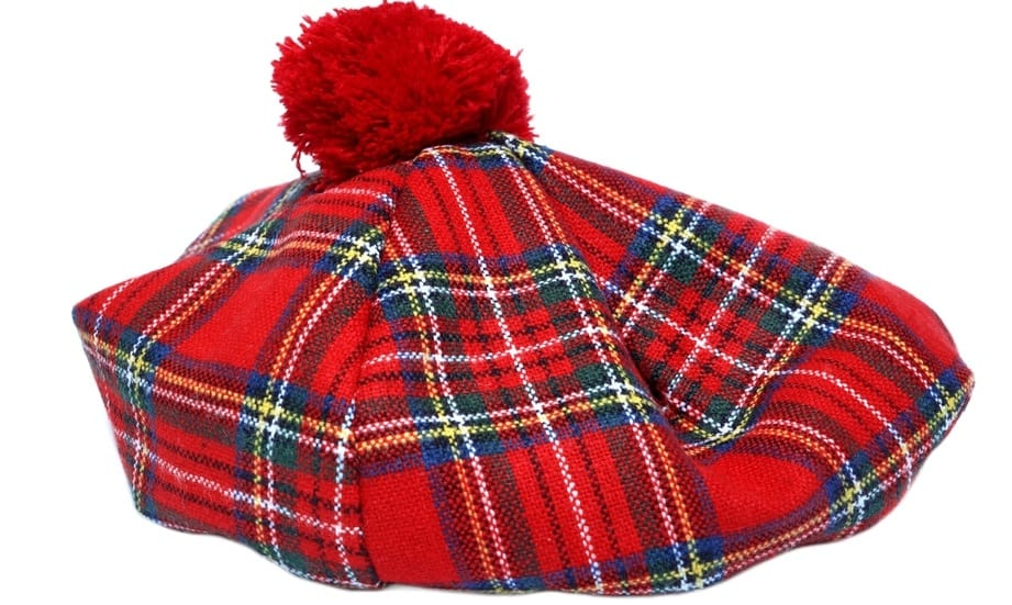 This is a traditional Irish tartan bonnet with checkered pattern and pompom.