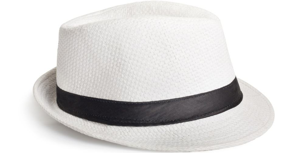 A close look at a white woven fedora hat with a black band.