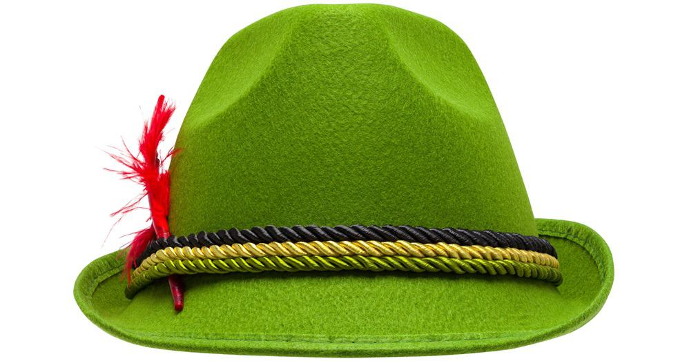 This is a close look at a green Bavarian tylorean hat with a feather on the side.