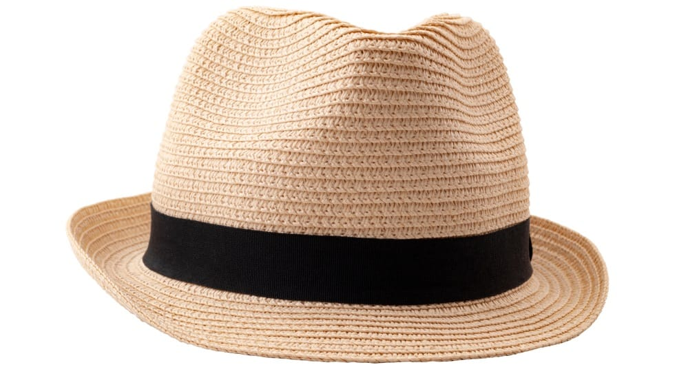 This is a beige straw woven fedora hat with a black band.