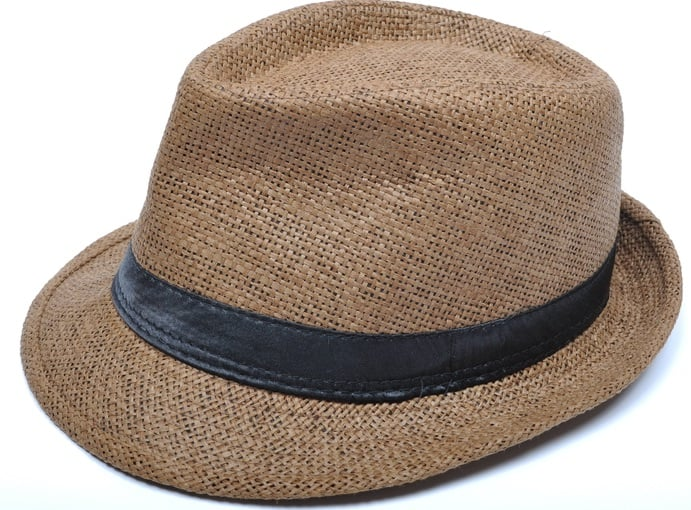 This is a brown woven trilby hat with black leather band.