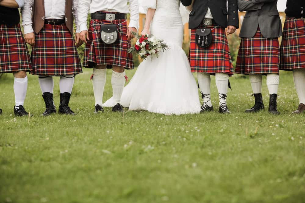 A close look at the bride and grooms men at a traditional Scottish wedding.