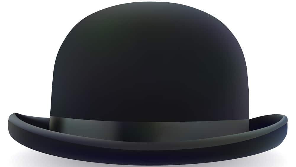 A close look at a black bowler hat with a black band.