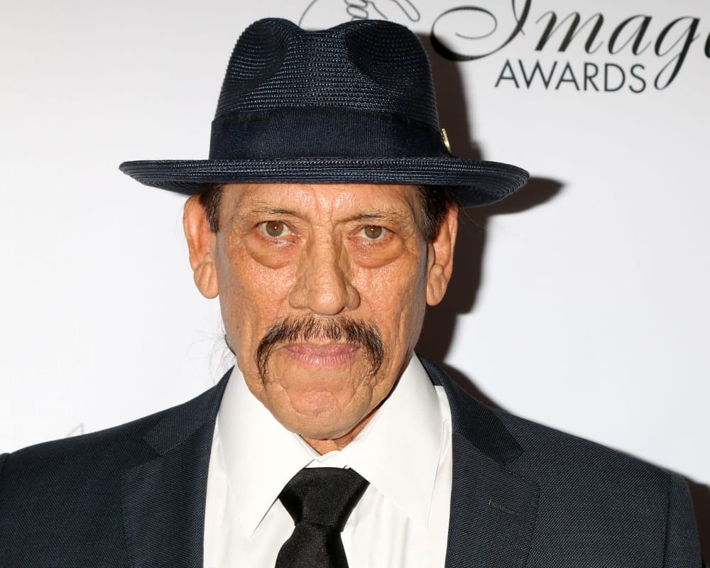 Danny Trejo attended the 2018 Imagen Awards wearing a fedora.