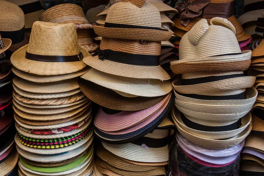 This is a close look at stacks of fedoras for sale.
