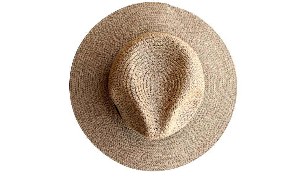 This is a top view of a straw fedora hat with a dark band.