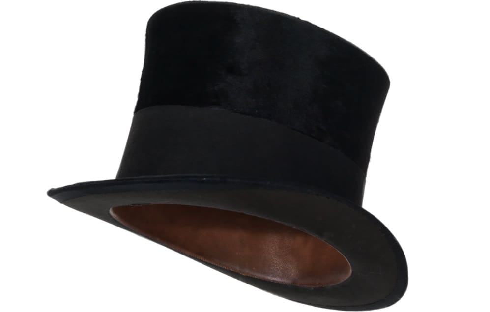 This is a close look at a vintage felt black top hat.
