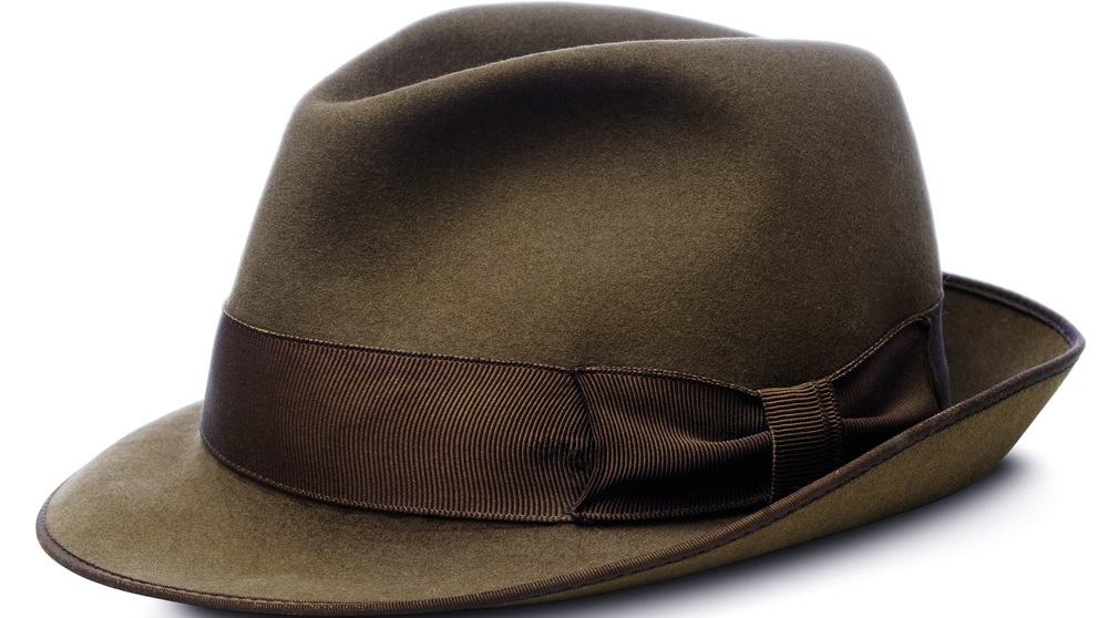 A close look at a brown homburg hat with a darker brown band.