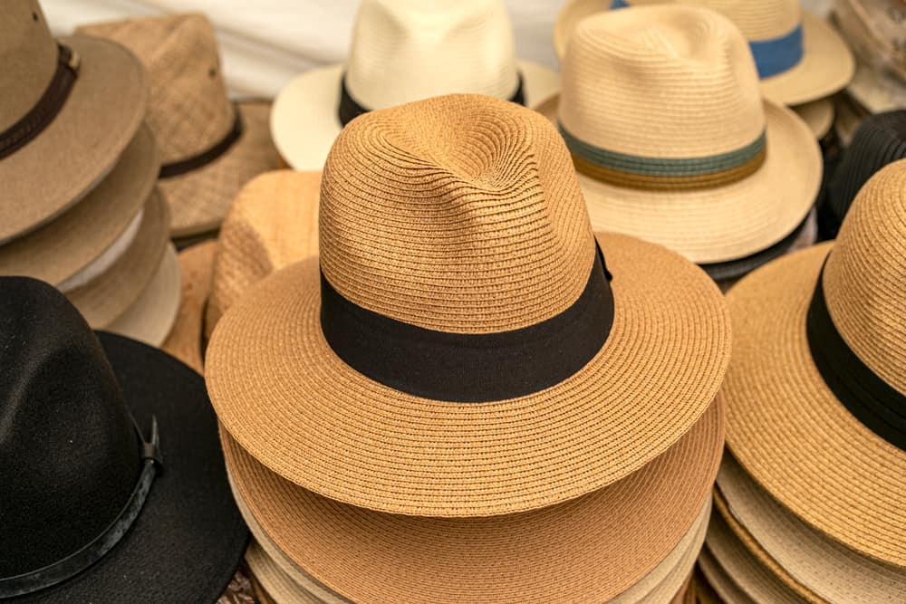 Various panama hats on display for sale.