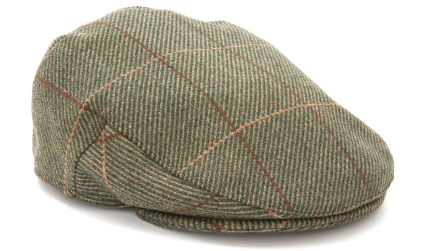 This is a green flat cap beret with a tweed pattern.
